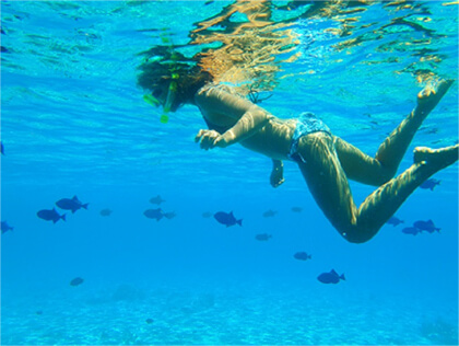 Woman Snorkelling at Cocos Islands