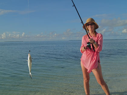 Woman fishing at Cocos Islands